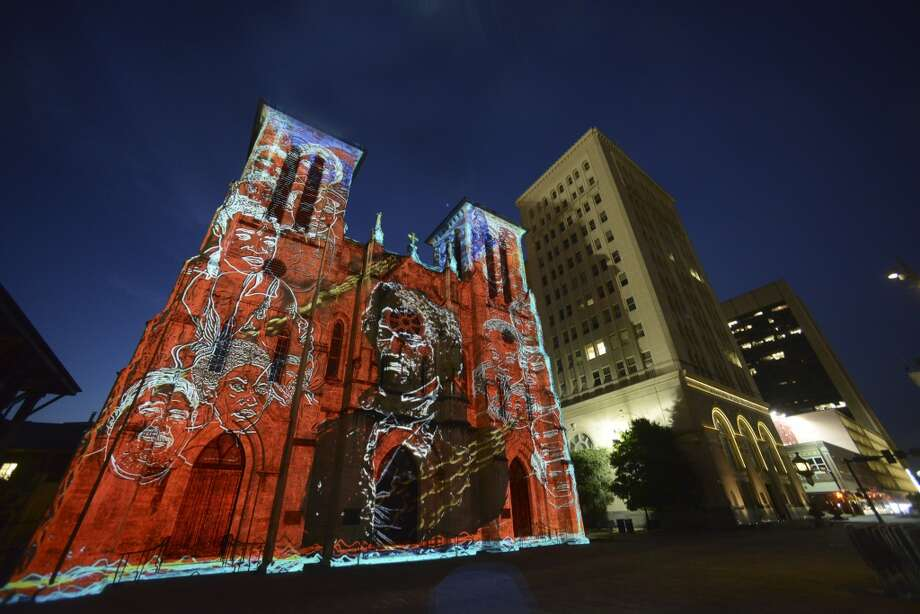 """An image of African American social reformer Frederick Douglass is projected onto San Fernando Cathedral during a sneak peek showing of """"San Antonio — The Saga"""" by renowned French artist Xavier de Richemont, on Wednesday, June 11, 2014. The film visually narrates the historical discovery, settlement and development of San Antonio. Photo: San Antonio Express-News"""