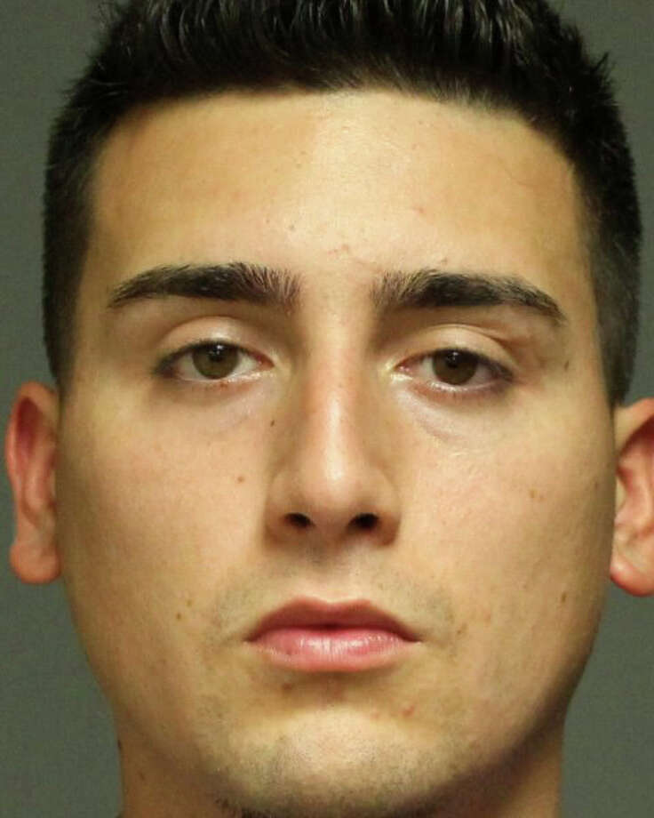 Jonathan Acuna, 23, of Stamford was charged Tuesday with trying to steal a $600 wheel of copper wire from the local Home Depot. Photo: Fairfield Police Department / Fairfield Citizen