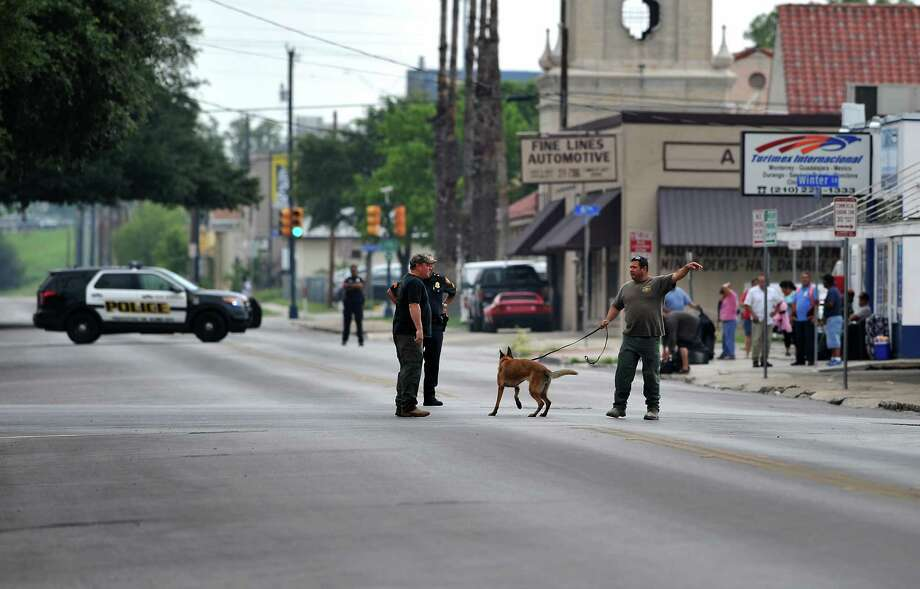 A suspicious package call came in from a janitor near the corner of N. Alamo Street and McCullough Ave. in downtown San Antonio.  Members of the San Antonio Police Department bomb unit as well as a bomb-sniffing dog were brought in to assess the package.  Police blocked off several streets to car and pedestrian traffic in all directions. Photo: Michel Fortier/San Antonio Expre, Photos Courtesy Of Xavier De Ric / 2014 San Antonio Express-News