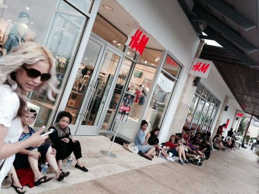 San Antonio fashionistas wrap around H&M for the noon opening of the store Thursday. Already 300 or more on line.
