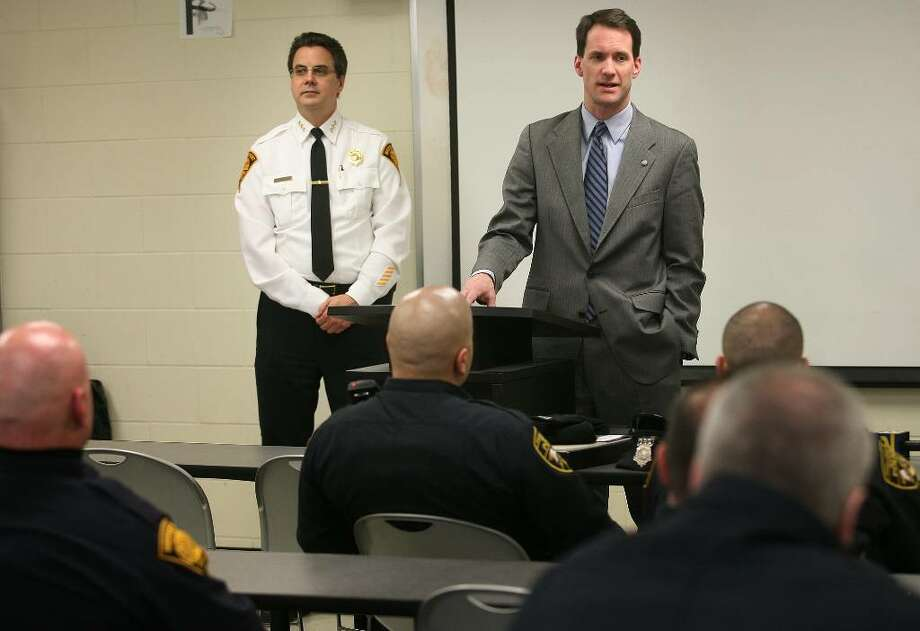 Flanked by Bridgeport Police Chief Joe Gaudett, left, Congressman Jim Himes addresses officers at the start of the 4pm shift, announcing the receipt of stimulus funds for the hiring of twenty additional police officers, at Bridgeport Police Headquarters on Monday, February 15, 2010. Photo: Brian A. Pounds / Connecticut Post