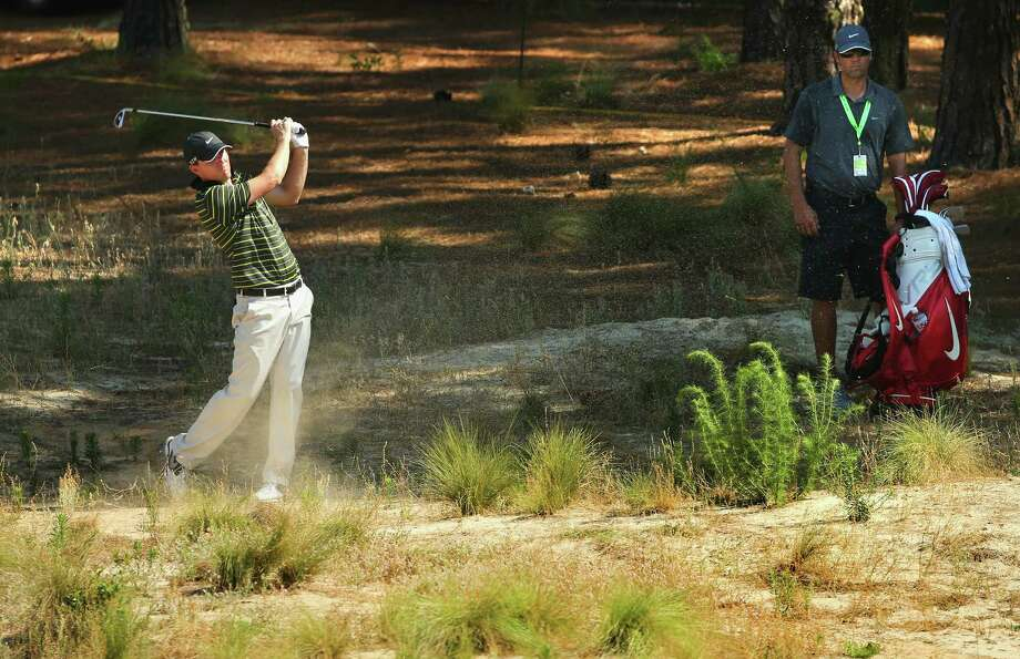 PINEHURST, NC - JUNE 11:  Russell Henley of the United States hits a shot during a practice round prior to the start of the 114th U.S. Open at Pinehurst Resort & Country Club, Course No. 2 on June 11, 2014 in Pinehurst, North Carolina. Photo: Mike Ehrmann, Getty Images / 2014 Getty Images