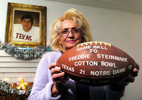 AURORA ,CO--DECEMBER 30TH 2005--Gloria Steinmark at her home in Aurora Friday afternoon holds a game ball from the Cotton Bowl January 1st 1970, given to her son, Freddie Steinmark, a Texas football star who died of cancer in the 70's. THE DENVER POST/ ANDY CROSS Photo: Andy Cross, Getty Images / Denver Post