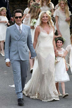 What a difference a few years can make. Kate Moss married John Galliano in 2011. Photo: Getty Images / 2011 FilmMagic