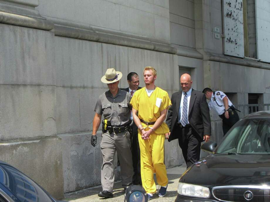 A state trooper leads Anthony Repp, in jail clothing, from the Rensselaer County Courthouse on Thursday, Aug. 8, 2013. (Bob Gardinier/Times Union) ORG XMIT: MER2013080813560090