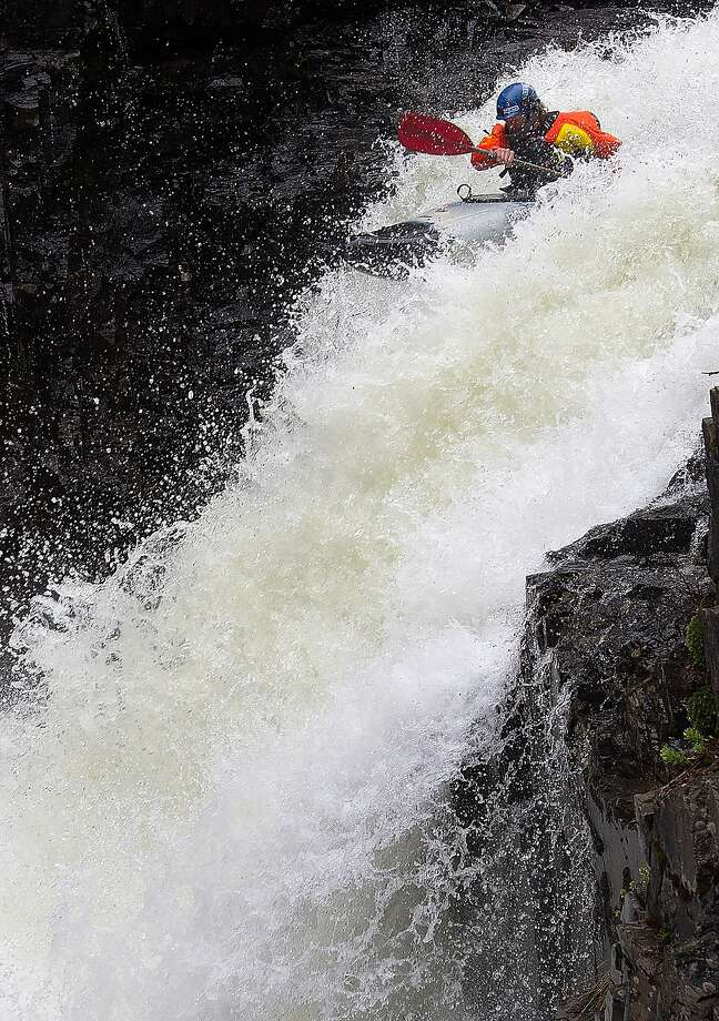 Joy riding:A kayaker sails over a waterfall on Oh Be Joyful Creek outside Crested Butte, Colo. A heavy snowmelt has the creek flowing near capacity. Photo: Christian Murdock, Associated Press
