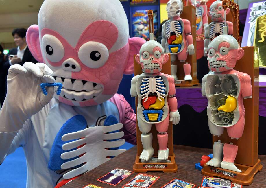 Give me back my colon, please:Japanese toy maker Megahouse unveils the new anatomy-themed figures of its Jintai-mokei game at the Tokyo Toy Show. Photo: Yoshikazu Tsuno, AFP/Getty Images