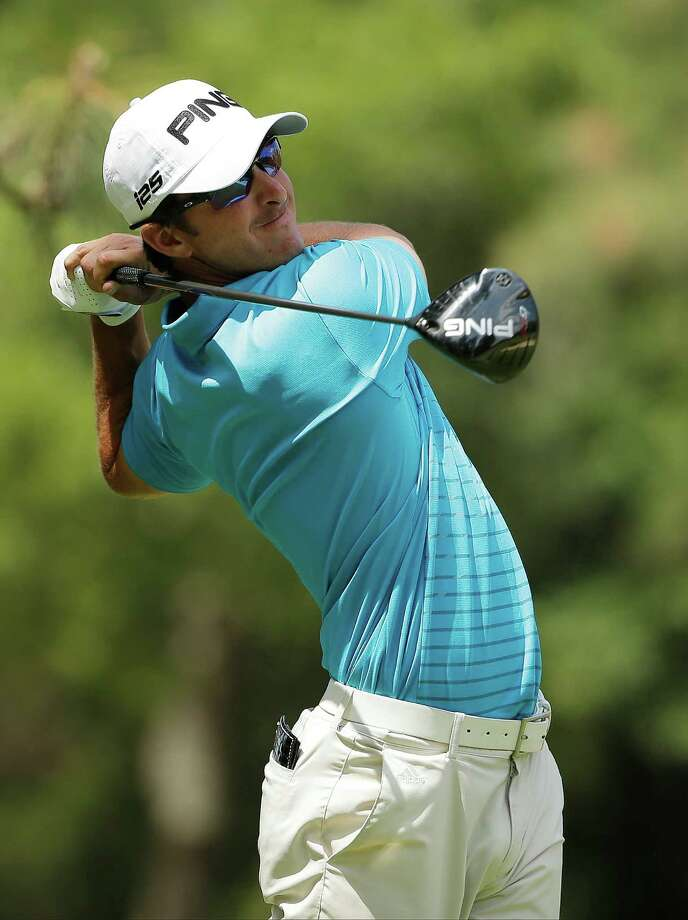 Anthony Broussard watches his tee shot on the second hole during the first round of the U.S. Open golf tournament in Pinehurst, N.C., Thursday, June 12, 2014. (AP Photo/Chuck Burton) Photo: Chuck Burton, STF / AP