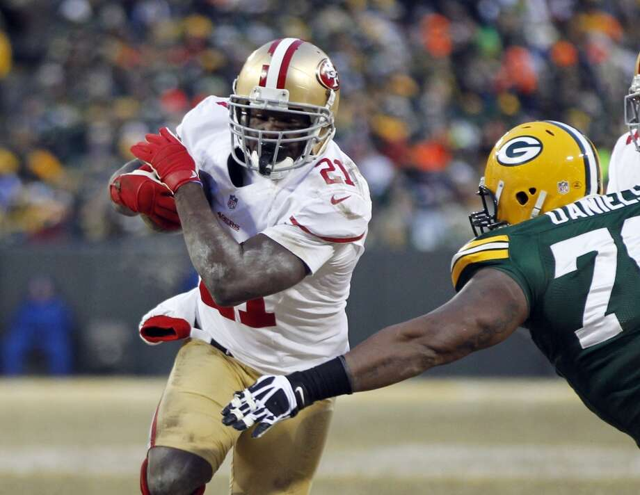 8. Frank Gore | San Francisco 49ers | $6,404,183 APY 2013 stats: 276 rushing attempts, 1,128 yards, 9 touchdowns | 16 receptions, 141 yards Photo: Mike Roemer, Associated Press