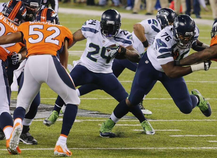 5. Marshawn Lynch | Seattle Seahawks | $7,500,000 APY2013 stats: 301 rushing attempts, 1,257 yards, 12 touchdowns | 36 receptions, 316 yards, 2 touchdowns Photo: Matt York, Associated Press