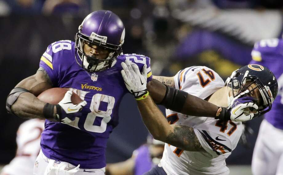 1. Adrian Peterson | Minnesota Vikings | $14,380,000 APY 2013 stats: 279 rushing attempts, 1,266 yards, 10 touchdowns | 29 receptions, 171 yards, touchdown Photo: Ann Heisenfelt, Associated Press