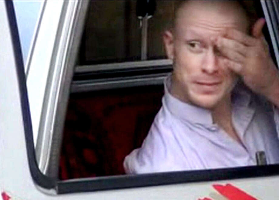 In this image taken from video obtained from Voice Of Jihad Website, which has been authenticated based on its contents and other AP reporting, Sgt. Bowe Bergdahl, sits in a vehicle guarded by the Taliban in eastern Afghanistan. A U.S. defense official says released captive Army Sgt. Bowe Bergdahl is scheduled to arrive at a military medical center in Texas on Friday. The official, who spoke Thursday on condition of anonymity because the plan has not been publicly announced, declined to provide details. Officials had previously said the intention was for Bergdahl to be reunited with his family at Brooke Army Medical Center in San Antonio. Photo: Uncredited, AP / Voice Of Jihad Website