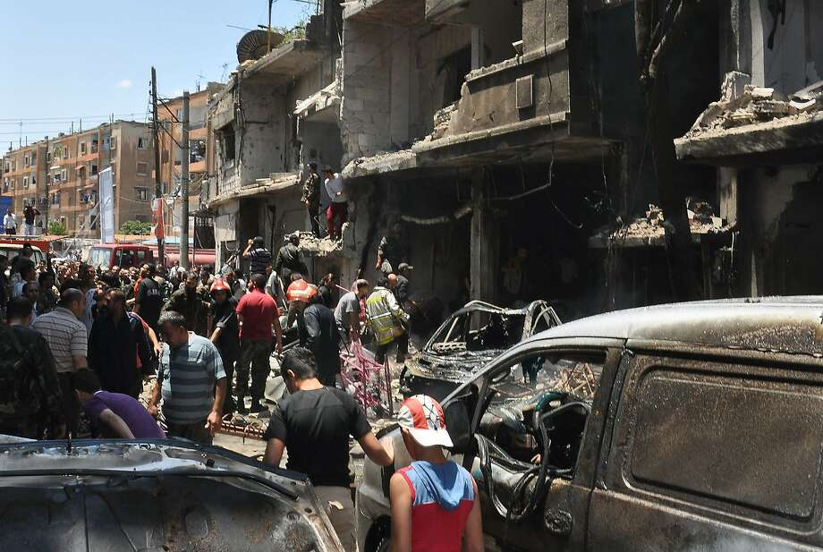 "A handout picture released by the official Syrian Arab News Agency (SANA) reportedly shows the scene of a car bomb explosion in the Wadi Dahab neighborhood in the central city of Homs. At least seven people were killed when a car bomb exploded in the central Syrian city of Homs Thursday, Syrian state media reported. ""Seven killed and others injured according to a first toll in a terrorist car bomb explosion in Wadi Dahab in Homs,"" state television said. AFP PHOTO/HO/SANA    == RESTRICTED TO EDITORIAL USE - MANDATORY CREDIT ""AFP PHOTO / HO / SANA"" - NO MARKETING NO ADVERTISING CAMPAIGNS - DISTRIBUTED AS A SERVICE TO CLIENTS ===-/AFP/Getty Images Photo: -, AFP/Getty Images"