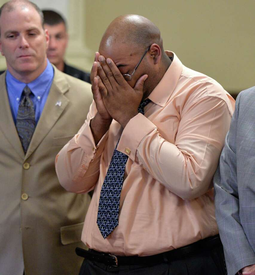 Adrian Thomas, flanked by his defense team, holds his hands to his head after being acquitted of second-degree murder in the death of his infant son, Matthew Dante Thomas,Thursday afternoon, June 12, 2014, at the Rensselaer County Courthouse in Troy, N.Y. (Skip Dickstein / Times Union) Photo: SKIP DICKSTEIN