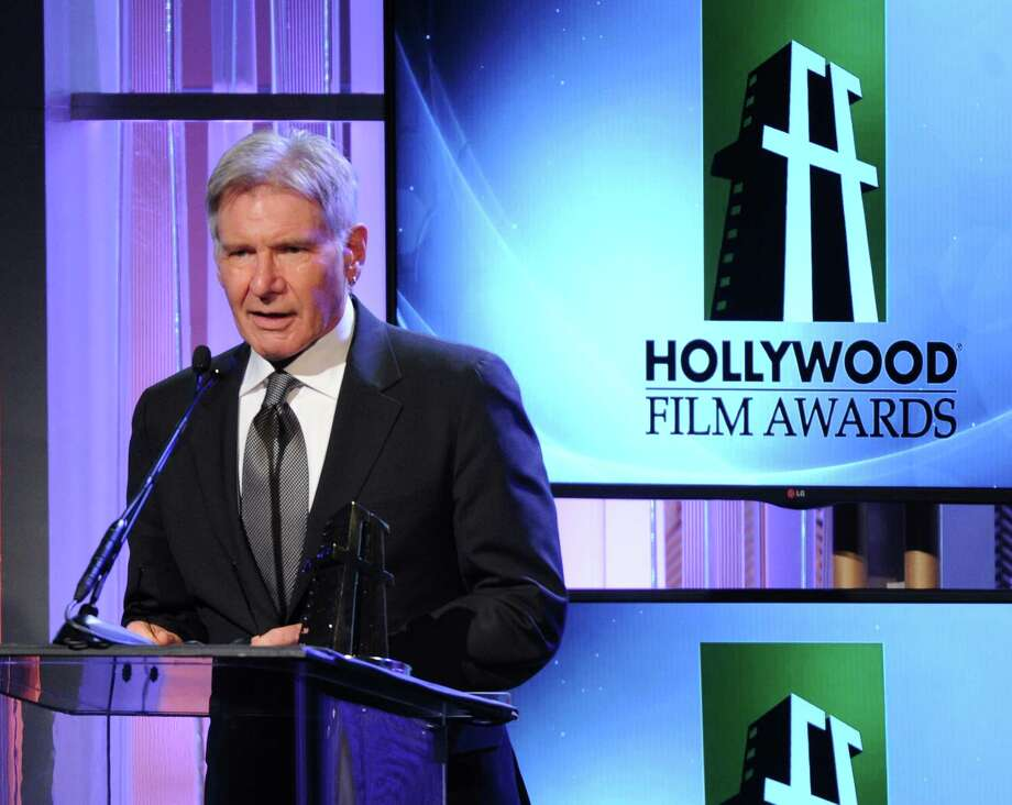 "FILE - In this Oct. 21, 2013 file photo, Harrison Ford accepts the ""Hollywood Career Achievement Award"" onstage during the 17th Annual Hollywood Film Awards Gala at the Beverly Hilton Hotel in Beverly Hills, Calif. Ford has been injured on the set of ""Star Wars: Episode VI"" and was taken to a hospital. Disney said the 71-year-old actor was being treated for an ankle injury that happened during filming Thursday, June 12, 2014.  (Photo by Frank Micelotta/Invision/AP, file) Photo: Frank Micelotta, Frank Micelotta/Invision/AP / Invision"