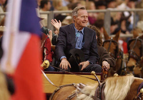 George Bush rides in the openingn  procession of the Houston Livestock Show and Rodeo in 2003. Photo: CHRISTOBAL PEREZ, STF / HOUSTON CHRONICLE