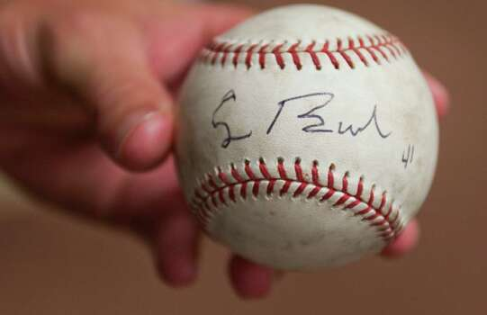 Former President George H.W. Bush signature is seen the ball he autographed for  Houston Astros pitcher Chris Sampson in 2009. Photo: Smiley N. Pool, Staff / Houston Chronicle