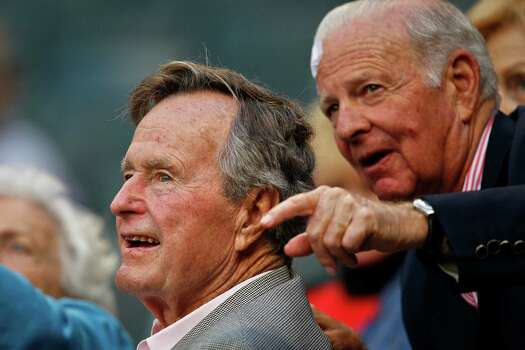Former President George H.W. Bush and James A. Baker talk before the start of the 1st inning of an  Astros game in 2011. Photo: Michael Paulsen, Staff / Houston Chronicle