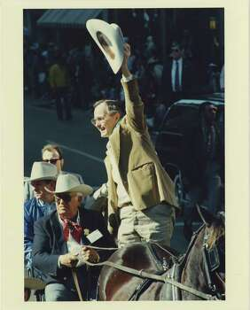 Vice President George Bush  as grand marshal of the Houston Livestock Show and Rodeo parade in 1988. Photo: Craig Hartley, HP Staff / Houston Post files