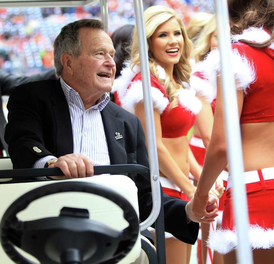 Former President George H.W. Bush  on the sidelines before the start of a Texans  game at Reliant Stadium, Dec. 22, 2013. Photo: Karen Warren, Staff / © 2013 Houston Chronicle