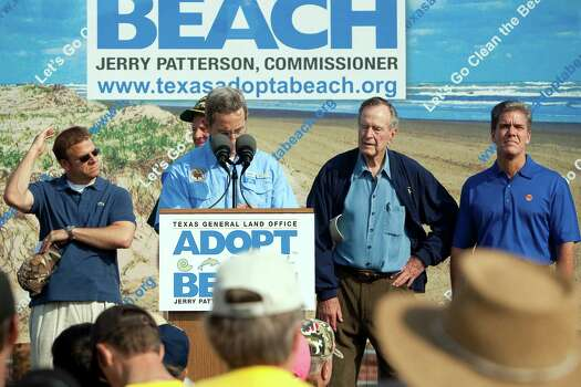 Texas General Land Office commissioner, Jerry Patterson, addresses the gathered group of volunteers prior to kicking off a massive cleanup effort  on the Bolivar Peninsula. Others on stage, left to right, include, business owner, Tillman Fertitta, former secretary of state, James Baker, Former President, George H. W. Bush, and Shell Oil Company President, Marvin Odum. Photo: Todd Spoth, Freelance / Freelance