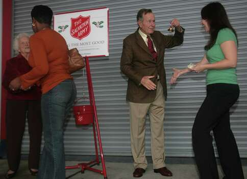 Former president George H.W. Bush rings a bell for the Salvation Armyin 2006. Photo: Mayra Beltran, Staff / Houston Chronicle