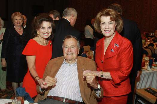 Linda McReynolds, from left, President George H. W. Bush and Jeanie Kilroy Wilson at the Salvation Army luncheon. Photo: Gary Fountain, Freelance / Copyright 2013 Gary Fountain.