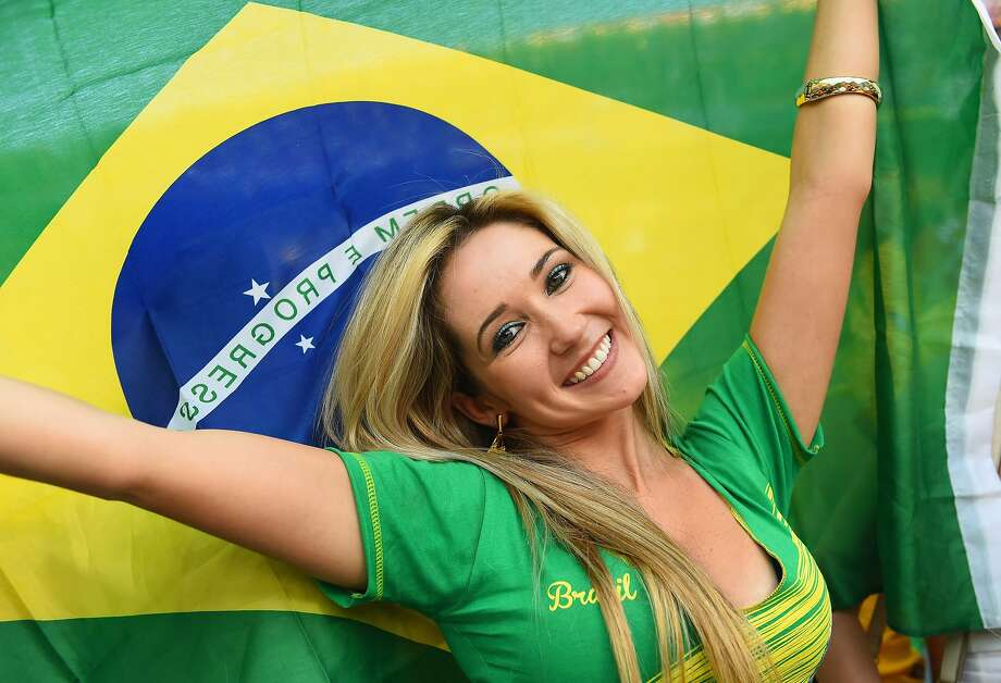 A fan waves a Brazilian flag during the 2014 FIFA World Cup Brazil Group A match between Brazil and Croatia at Arena de Sao Paulo on June 12, 2014 in Sao Paulo, Brazil. Photo: Christopher Lee, Getty Images