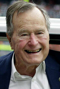 FILE - In this Nov. 4, 2012 file photo, former president George H.W. Bush pauses for a photo before an NFL football game in Houston between the Buffalo Bills and the Houston Texans. Former President George H.W. Bush is celebrating his 90th birthday in Maine. Thursday June 12, 2014. A family spokesman says a private dinner Thursday evening features a guest list of more than 200 friends and relatives. (AP Photo/Eric Gay, File) Photo: Eric Gay, STF / AP