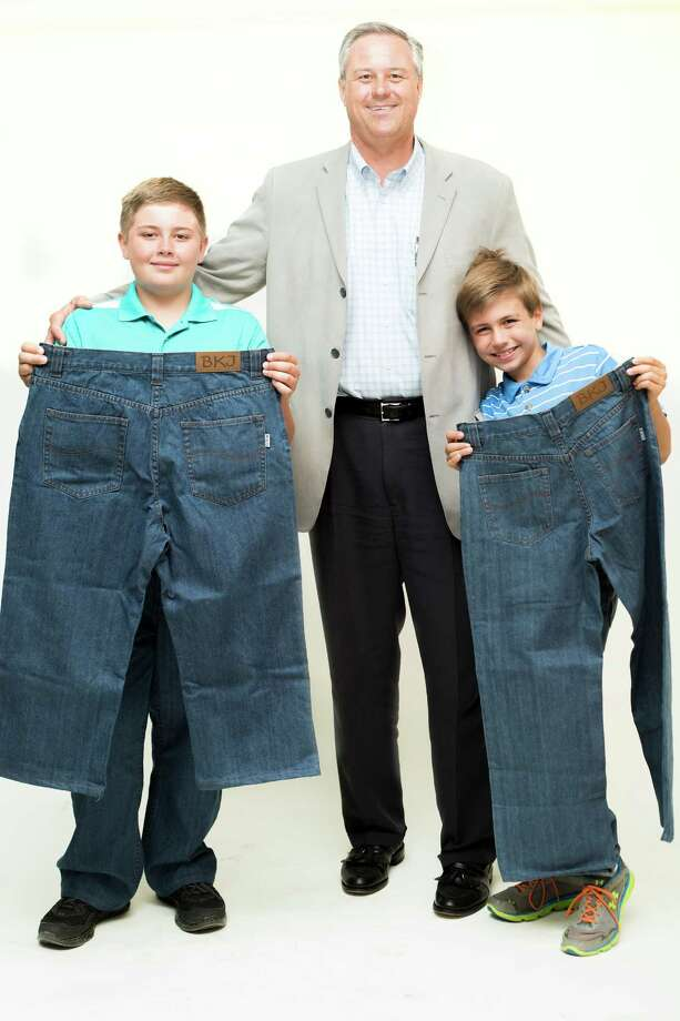 "Alec, 11, left, and his brother, Kyle, 9, right, stand with their father and founder of Big Kidz Jeanz, Steve, as they display Big Kidz Jeans on Thursday, June 6, 2014 in Albany, N.Y.  Steve Frazee is the founder of Big Kidz Jeanz, a company he started because he had a hard time finding pants to fit his ""husky"" 11-year-old, Alec, and tall 9-year-old, Kyle.  (Tom Brenner/ Special to the Times Union) Photo: Tom Brenner / ©Tom Brenner/ Albany Times Union"