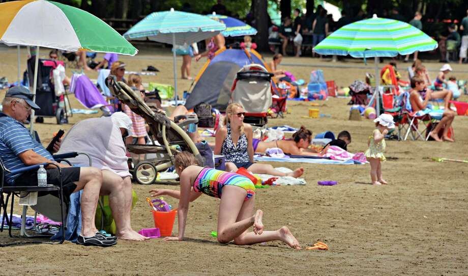 Beach goers at Moreau Lake State Park  in Moreau, NY Thursday July 11, 2013.  (John Carl D'Annibale / Times Union) Photo: John Carl D'Annibale