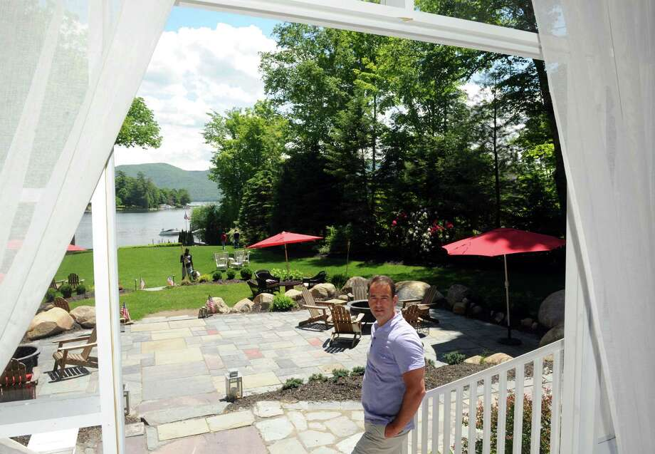Chateau on the Lake owner Ed Foy on the restaurants lake side patio Thursday June 5, 2014 in Bolton Landing, N.Y. (Michael P. Farrell/Times Union) Photo: Michael P. Farrell / 00027169A