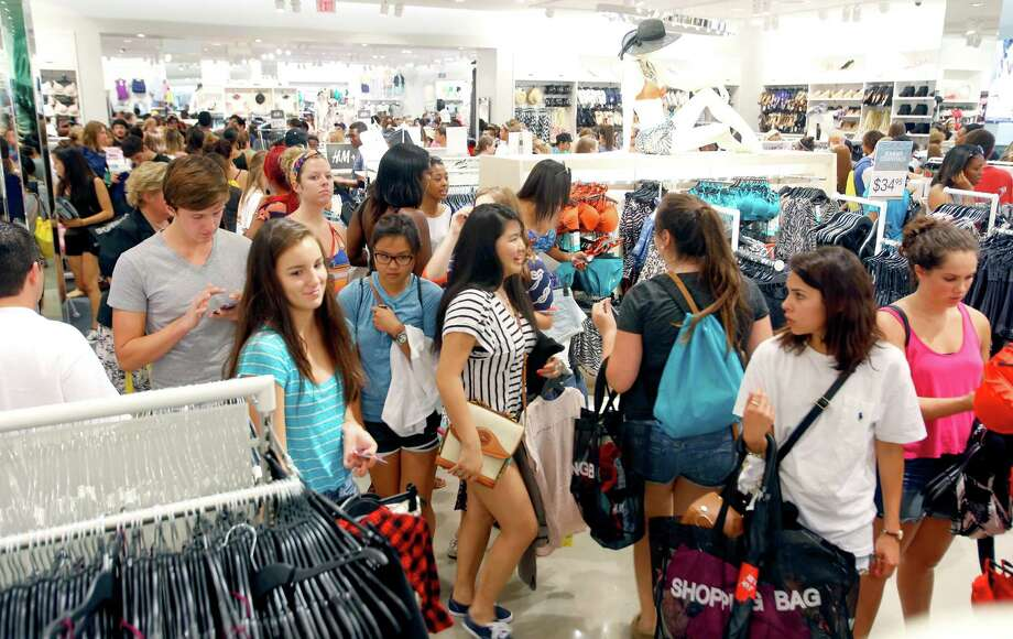 FILE - Some of the over 1,100 people who lined up for H&M clothing store's grand opening Thursday morning June 12, 2014 shop inside the store at the Shops at La Cantera. San Antonio will get a fifth H&M store in October. Photo: William Luther, San Antonio Express-News / © 2014 San Antonio Express-News
