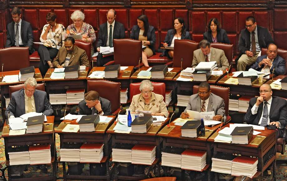 Members of the New York State Senate listen as bills are debated in the Senate Chamber Wednesday, June 11, 2014, at the Capitol in Albany, N.Y. (Lori Van Buren / Times Union) Photo: Lori Van Buren, Albany Times Union