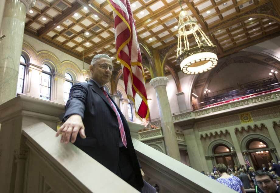 Assembly Speaker Sheldon Silver, D-Manhattan, walks in the Assembly Chamber at the Capitol on Wednesday, June 11, 2014, in Albany, N.Y. Silver renewed his push to increase the minimum wage and pass the Dream Act on Wednesday as state legislators worked to finish their work for the year. (AP Photo/Mike Groll) ORG XMIT: NYMG101 Photo: Mike Groll, AP