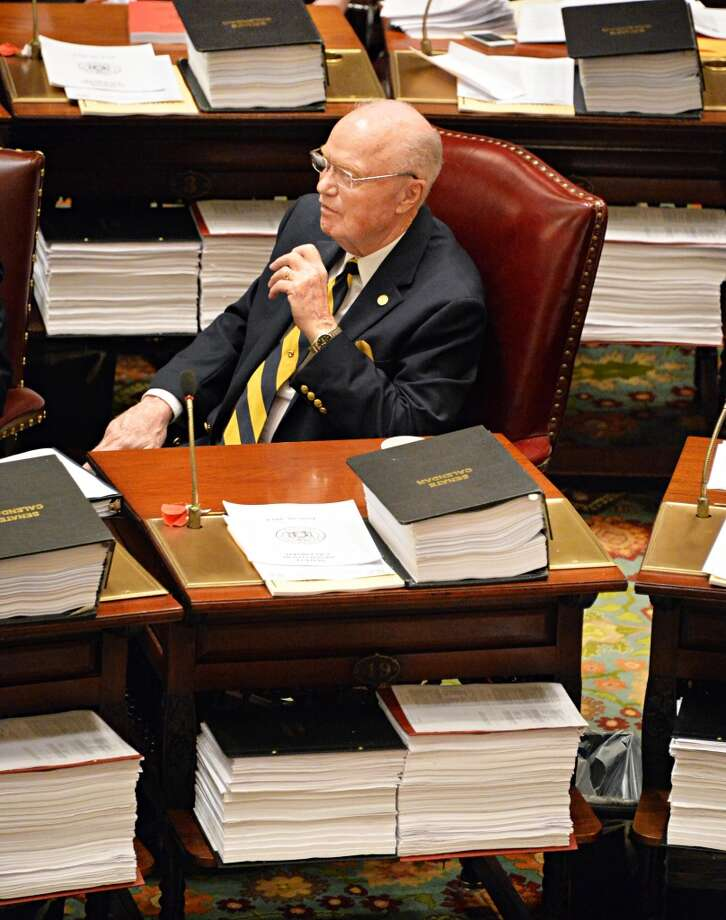 NYS Senator Hugh Farley is seemingly surrounded by bills during session at the Capitol Tuesday June 10, 2014, in Albany, NY.  (John Carl D'Annibale / Times Union) Photo: John Carl D'Annibale, Albany Times Union