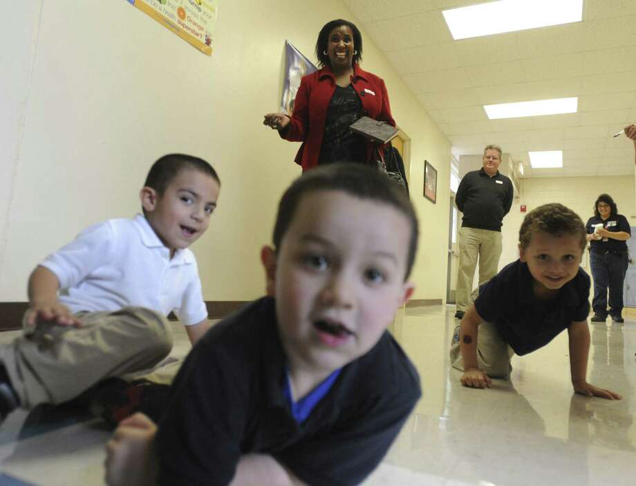 Mantsose Jane Sethusha, a lecturer at the University of South Africa, has done extensive research in pre-K. Here she interacts with pre-K students   at SAISD's Carroll Early Child Education Center. Photo: Billy Calzada / San Antonio Express-News / San Antonio Express-News