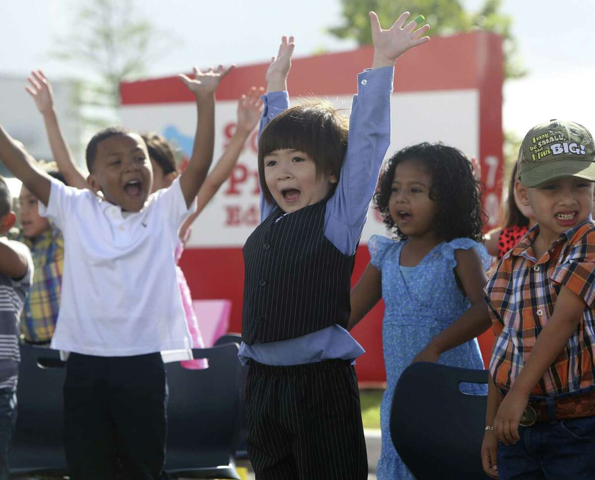 Pre-K 4 SA students sing and dance during their promotion ceremony. Pre-K 4 SA students were promoted to kindergarten, honoring their first education milestone.