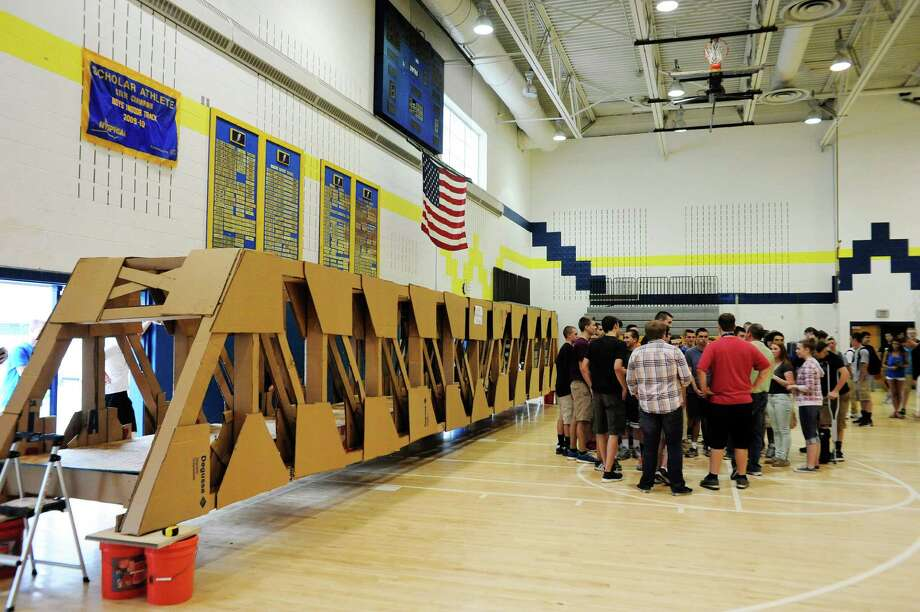 Students gather around their teacher, Matthew Duff, to go over how they will load students onto the 48-foot-long cardboard bridge at Averill Park High School Thursday, June 12, 2014, in Averill Park, N.Y.   (Paul Buckowski / Times Union) Photo: Paul Buckowski / 00027337A