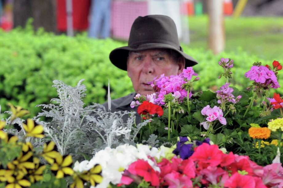 Paul VanArnum offers flowers at the Ballston Spa Farmers' Market Thursday afternoon, June 12, 2014, in Ballston Spa, N.Y. (Michael P. Farrell/Times Union) Photo: Michael P. Farrell / 00026074A
