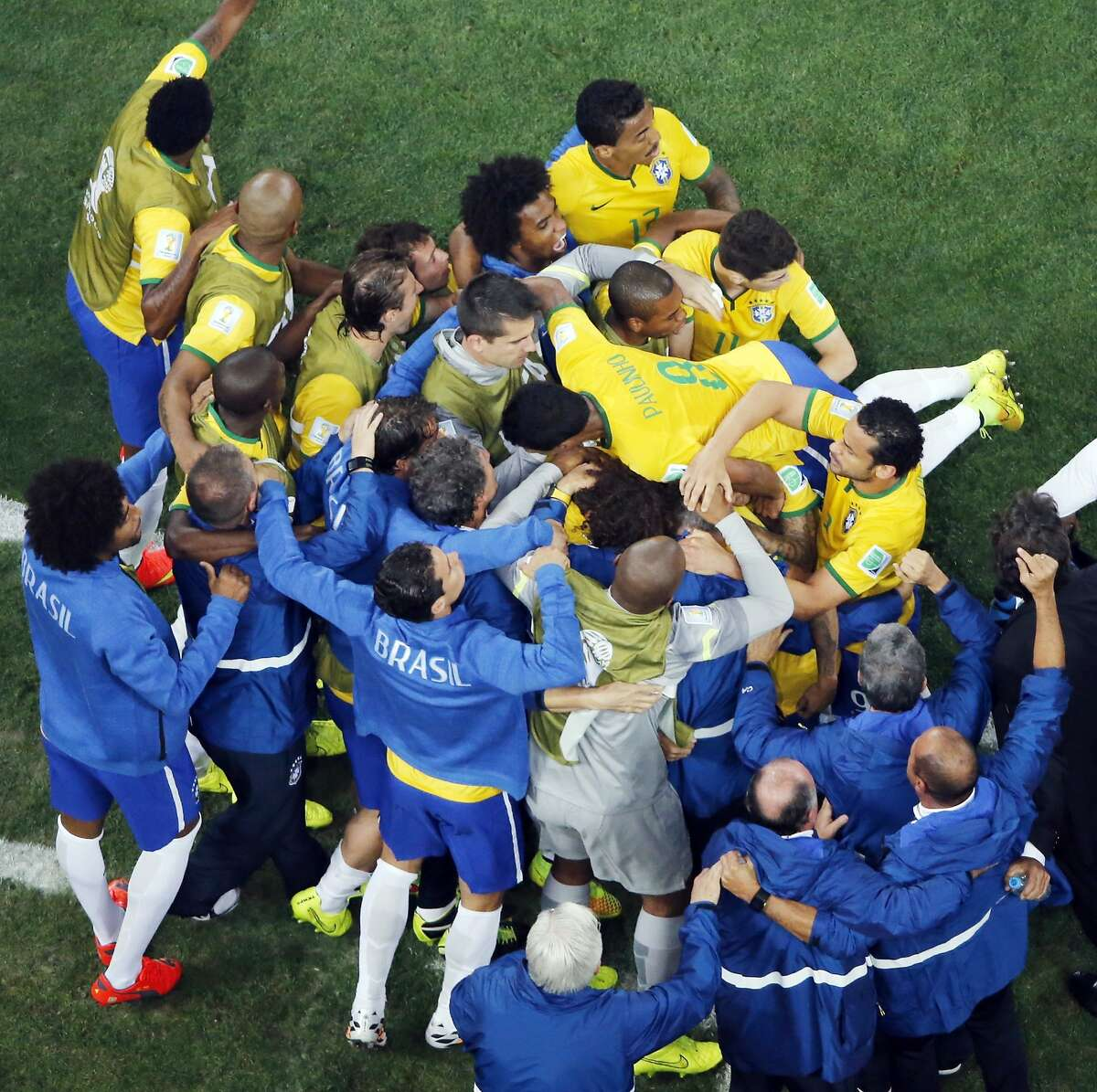 Brazil players celebrate Neymar's goal during the group A World Cup soccer match between Brazil and Croatia, the opening game of the tournament, in the Itaquerao Stadium in Sao Paulo, Brazil, Thursday, June 12, 2014.