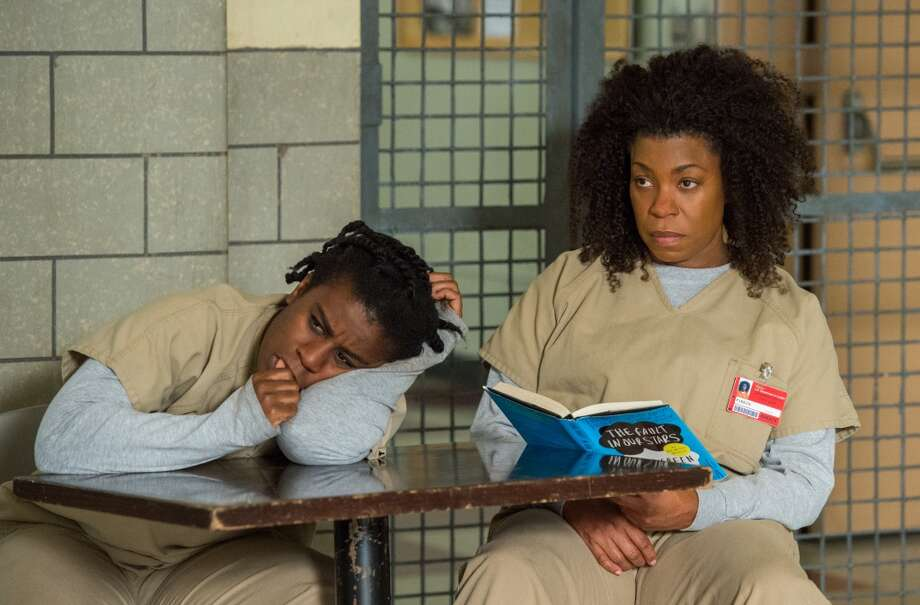 "Uzo Aduba (left) and Lorraine Toussaint (with John Green's ""The Fault in Our Stars"") in ""Orange Is the New Black."" Photo: David Giesbrecht"