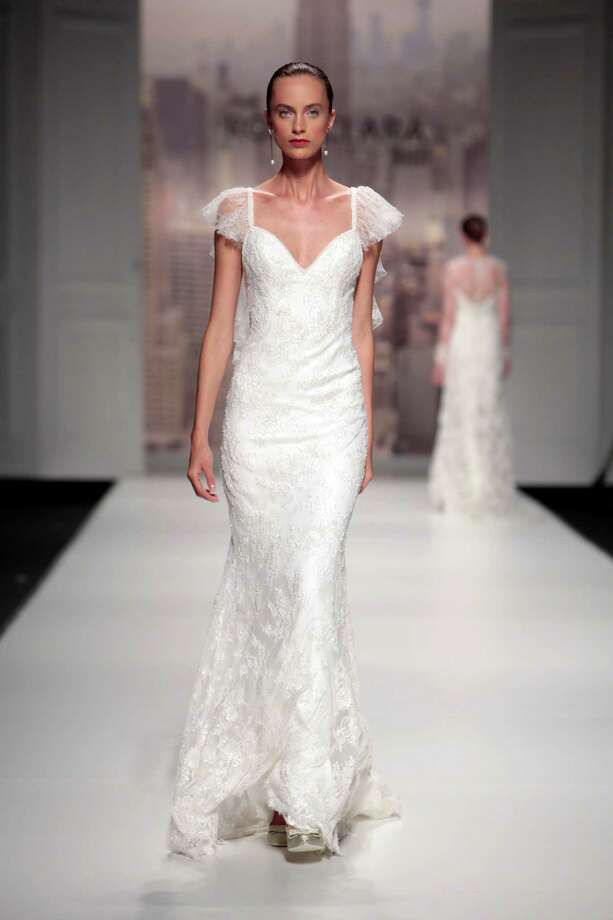 2014:  A model walks the runway for the latest Rosa Clara bridal collection at the Barcelona Bridal Week Photo: Miquel Benitez, Getty / 2014 Miquel Benitez
