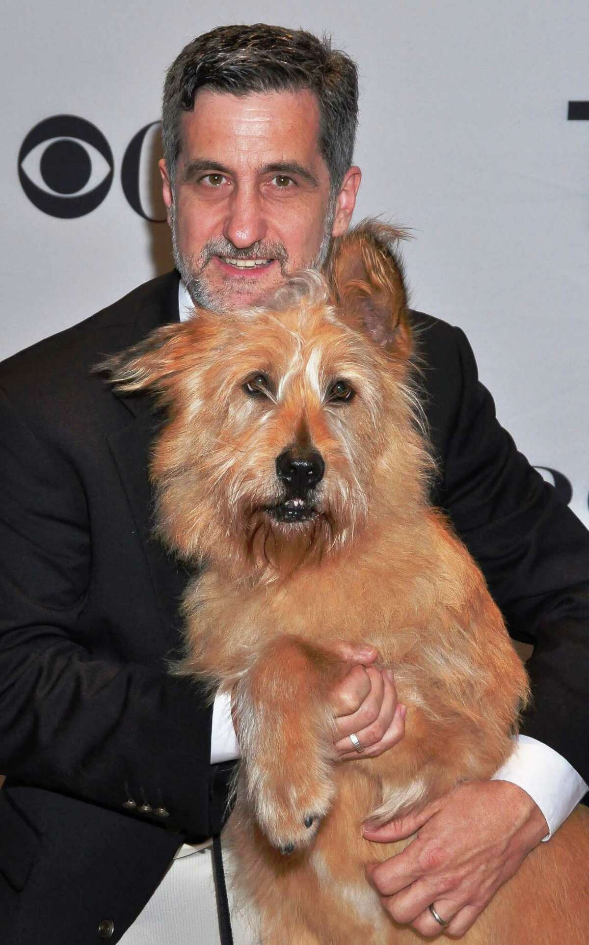 Famed Broadway animal trainer Bill Berloni poses with Oliver who is playing the role of