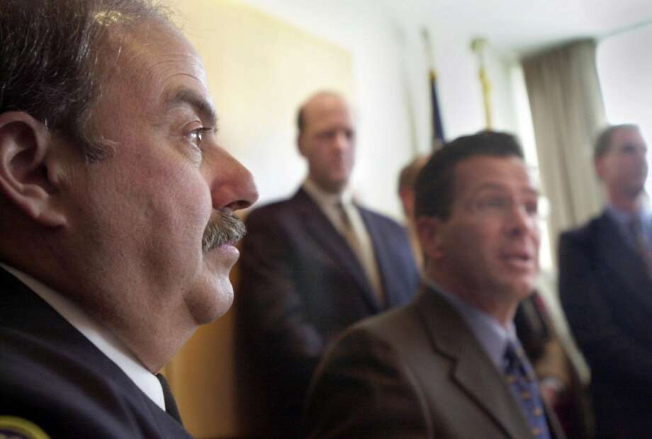 2001 FILE — Louis DeCarlo will be Stamford's next police chief. After a 31-year career with the department, DeCarlo said it was overwhelming to be named to succeed outgoing chief Dean Esserman, center. Mayor Dannel Malloy, right, praised DeCarlo for his dedication to the city. Photo: Andrew Sullivan, ST