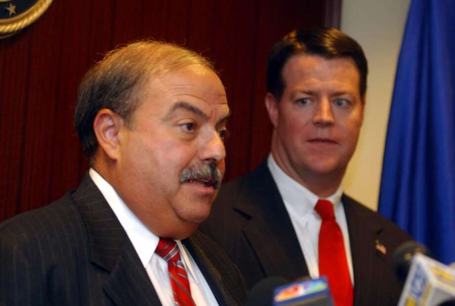2004 FILE — Stamford Chief of Police Louis DeCarlo addresses members of the media during a news conference announcing the indictment of 18 persons after a sting of organized crime in Connecticut at the offices of (R) Kevin J. O'Connor U.S. Attorney for the District of Connecticut. Photo: ST