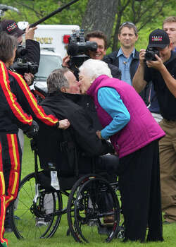 KENNEBUNKPORT, ME - JUNE 12: (EDITORS NOTE: Retransmission with alternate crop.) Former first lady Barbara Bush greets her husband and former U.S. President George H.W. Bush with a kiss after his successful skydive down to St. Anne's Episcopal Church on June 12, 2014 in Kennebunkport, Maine. The President is celebrating his 90th birthday today. Photo: Eric Shea, Getty Images / 2014 Getty Images