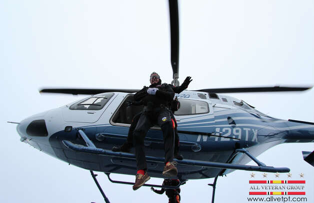 In this photo provided by the All Veteran Parachute Team, former President George H.W. Bush is tethered to Mike Elliott, a member of the All Veteran Parachute Team, on a jump from a helicopter as they celebrate Bush's 90th birthday in Kennebunkport, Maine, Thursday, June 12, 2014. (AP Photo/All Veteran Parachute Team, Charles Cooley) Photo: Charles Cooley, Associated Press / All Veteran Parachute Team
