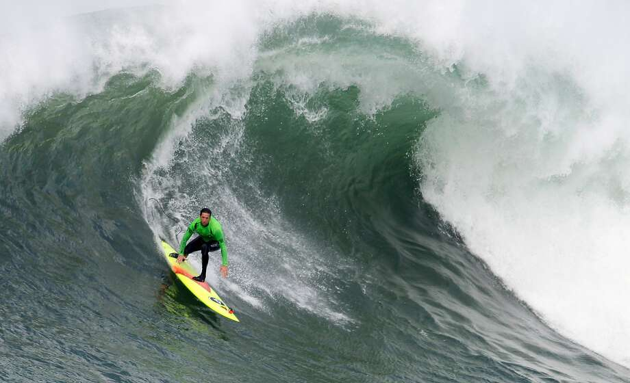 Ken Collins rides a wave during the semi-finals of the Maverick's Invitational surf contest in Half Moon Bay, Calif., on Friday, Jan. 24, 2014. Photo: Mathew Sumner, Special To The Chronicle