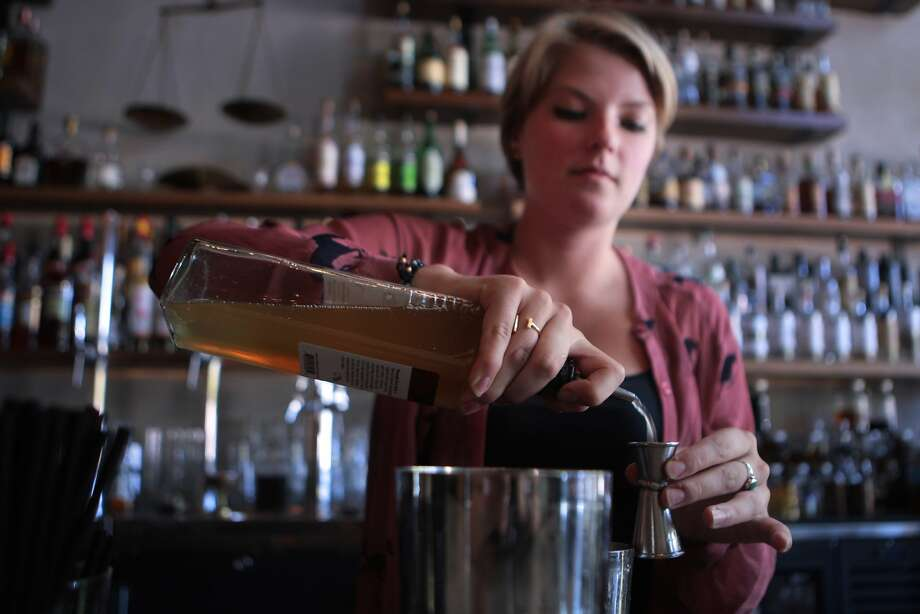 Bartender Nicole Kozlowski makes a Pisco punch, a popular cocktail invented in San Francisco in the 19th century. Photo: Kevin N. Hume, The Chronicle